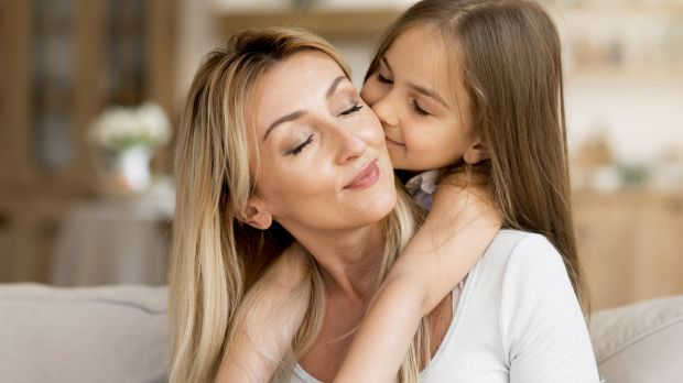 daughter-kissing-her-mother-home